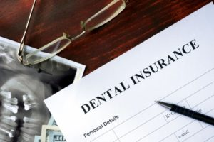 dental insurance form on dark wood table